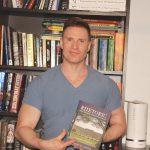 Greg Stevens shows off a new book